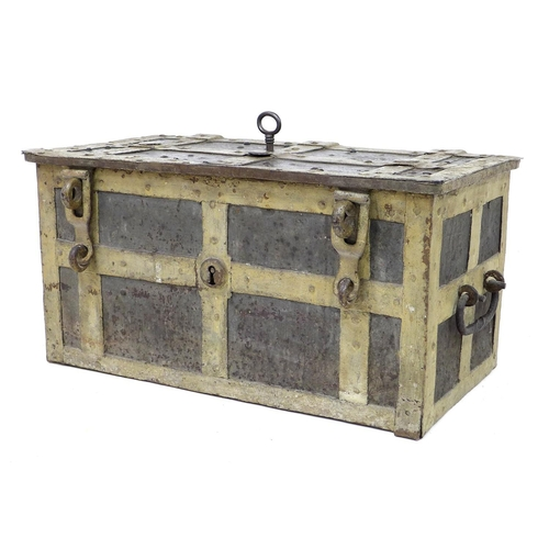 239 - A 17th century heavy cast iron strong box or 'Armada' chest, probably German, with working key, of r...