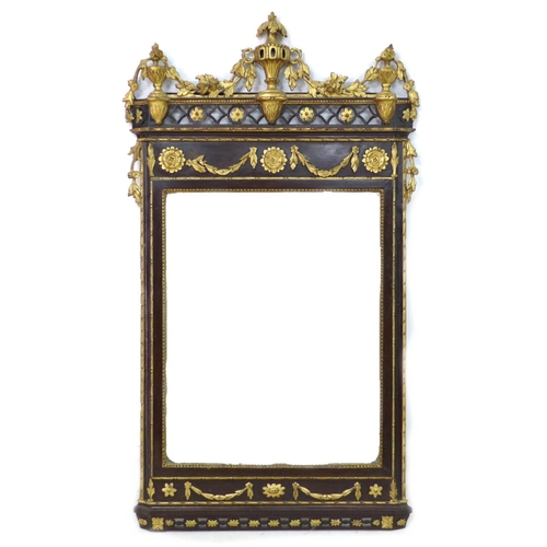 241 - An early 19th century giltwood framed wall mirror, with a carved giltwood surmount of foliate and fl...