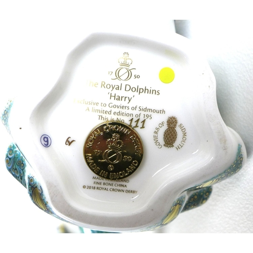 32 - A pair of Royal Crown Derby commemorative paperweights, modelled as 'The Royal Dolphins', 'Harry' an...