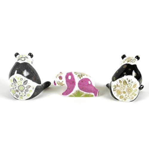 33 - A group of three Royal Crown Derby paperweights comprising 'Pink Baby Panda - Walking', limited edit...