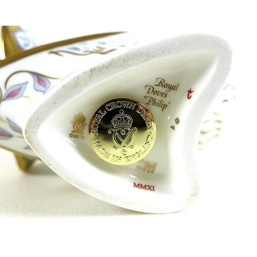 42 - A pair of Royal Crown Derby commemorative paperweights, modelled as 'Diamond Jubilee Doves' / 'Royal...