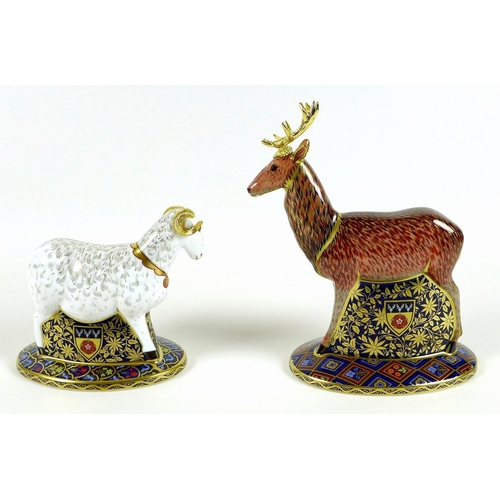 43 - A pair of Royal Crown Derby paperweights, modelled as 'The Heraldic Derbyshire Stag' and 'The Herald...