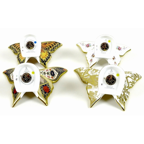 45 - A group of four Royal Crown Derby paperweights, all modelled as butterflies, comprising 'Peacock But...