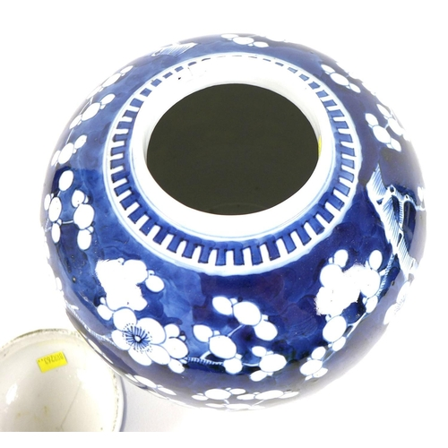 7 - A Chinese blue and white ginger jar and cover the cobalt blue ground decorated with cherry blossoms ...