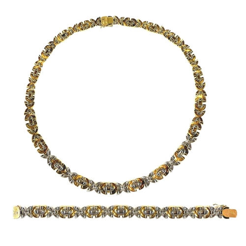 328 - An 18ct gold and diamond designer necklace and bracelet, formed of white gold X's, each studded with...