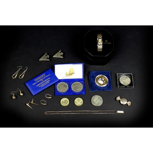79 - A small collection of silver jewellery and coins, including a sweet wrapper style locket, a necklace...