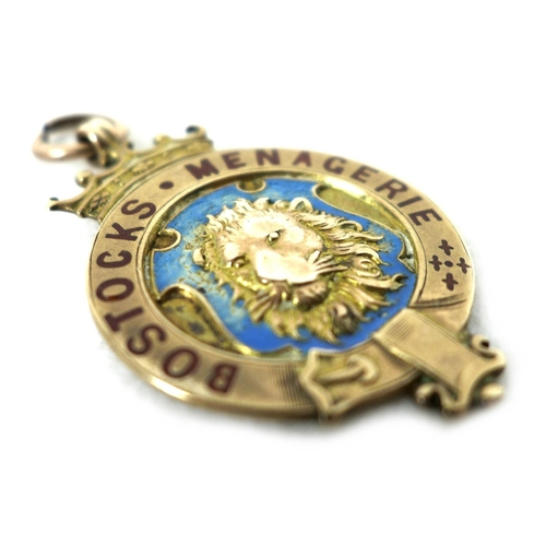 89 - An Edward VII 9ct gold medallion, of circular form with a central relief cast and pale blue enamelle...