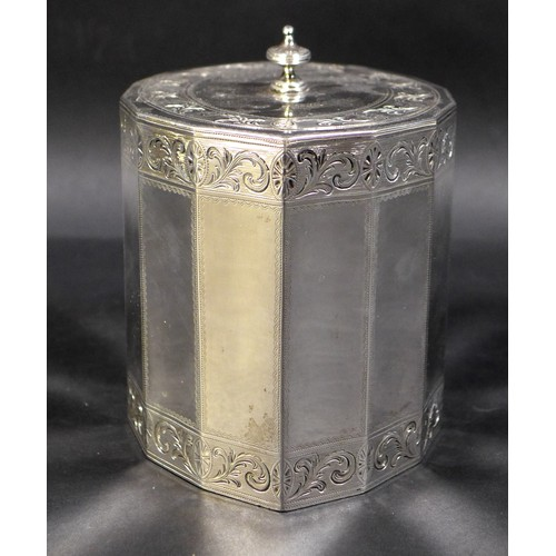 77 - A George III silver tea caddy, of fourteen sided navette form, the oval flush hinged cover with knop...