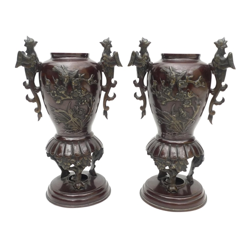 10 - A pair of decorative 20th century bronze vases, decorated with birds in prunus blossom and pheonix h...