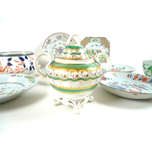 15 - A group of European and Asian ceramics, including an early 19th century French porcelain armorial ca...