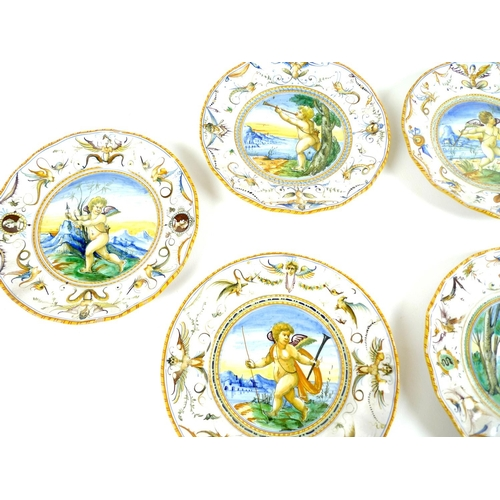 21 - A group of eleven Cantagalli maiolica pottery dishes, circa 1900, of Urbino type, circular form with...