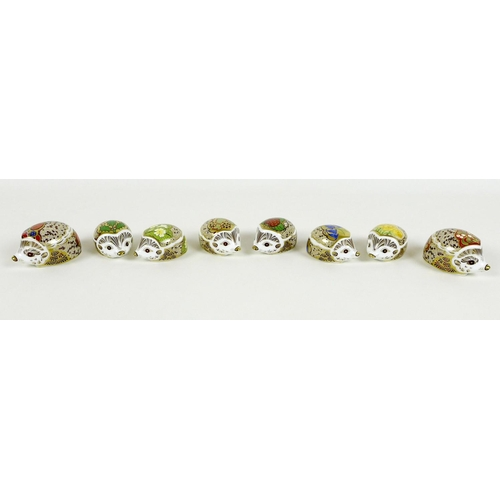 23 - A group of eight small Royal Crown Derby paperweights, all modelled as hedgehogs, comprising 'Brambl...