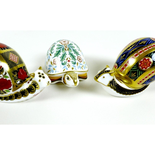 27 - A group of three Royal Crown Derby paperweights, comprising 'Garden Snail', limited edition 151/4500...