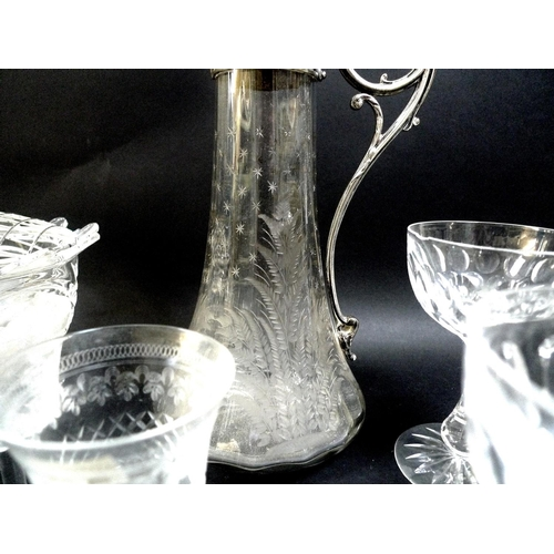 71 - A silver plated and etched glass claret jug, of flared fluted form, decorated with ferns and stars, ...