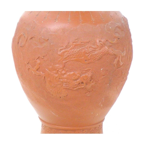 8 - A Chinese Yixing pottery vase, early to mid 20th century, with incised decoration of a dragon amidst...