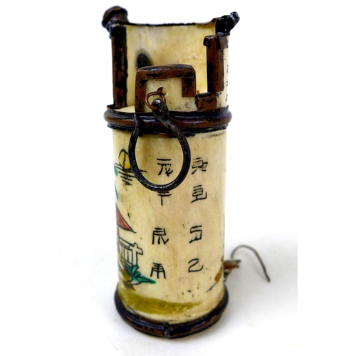 9 - A group of three Chinese opium pipes, the largest with white blossom on black enamels decoration, 7 ...