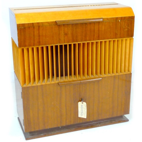 324 - A vintage 'Decola' radiogram, by The Decca Record Company Limited, Rd. Desn. 844055, 'Decola' No. 58...