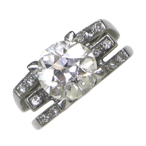 255 - An 18ct white gold and diamond solitaire ring, of modernist design, the brilliant cut stone approxim...