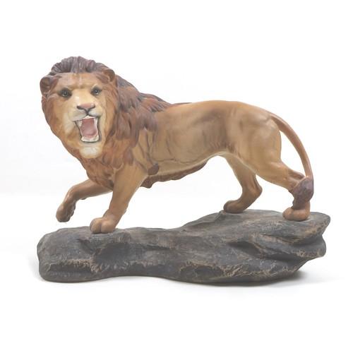 7 - A Beswick 'Lion on Rock', model 2554A, golden brown, satin matt, 21cm high.