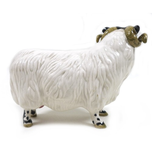 18 - A Beswick Black-Faced Ram, model 3071, black and white - gloss, 8.3cm high with a box.