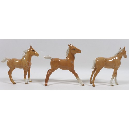 85 - A group of seven Beswick foal figurines, including 'Foal (Small, stretched, facing right), model 815...