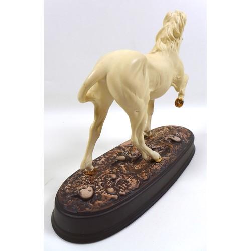 123 - A Beswick 'Unicorn' figurine, model 3021, cream - matt, 24cm high.