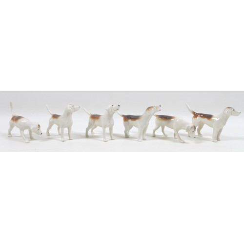 136 - A Beswick Hunting Family Group, comprising 'Huntsman', style two, standing, model 1501, brown gloss,...