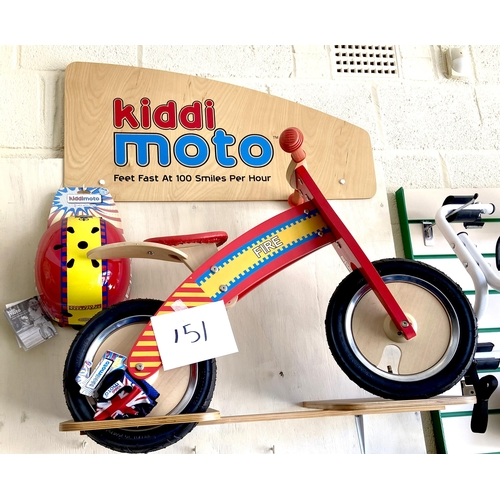 151 - A KiddiMoto children's wooden balance bike, red 'Fire' engine colours, red seat, together with a mat...
