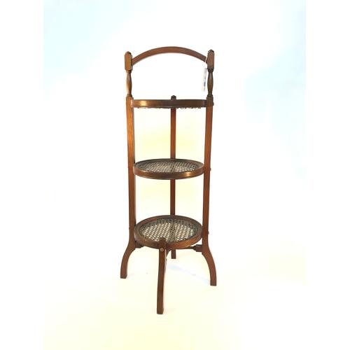 50 - Edwardian walnut three tier cane cake stand, each having a circular cane panel, H83cm...