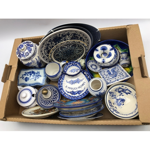 304 - Collection of continental pottery, mostly blue and white in one box