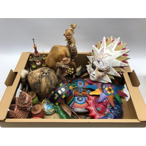 305 - Wooden model of a camel, pottery masks, butterfly wing pin dishes and miscellanea in one box