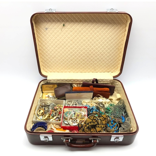331 - Quantity of costume jewellery in vintage suitcase