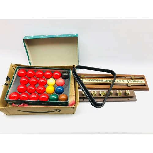 340 - Set of Aramith resin snooker balls, part set of Vitalite balls, score board, cue rack and triangle