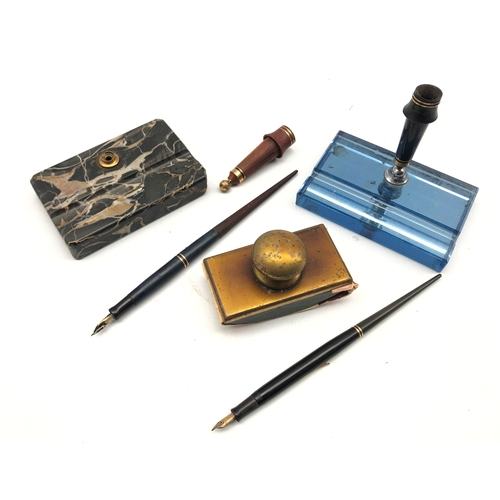 363 - Vintage glass pen stand, a hardstone pen stand, two dip pens and a brass mounted blotter