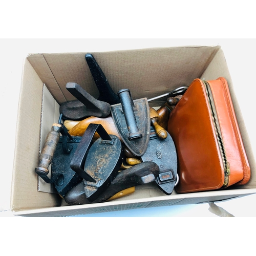 380 - Box iron, two flat irons, cobblers lasts, wooden shoe trees and a gentleman's vanity case