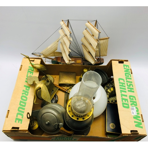 387 - Brass oil lamp, pair of brass shoe ornaments, Indian brass box, other metal ware and a model ship