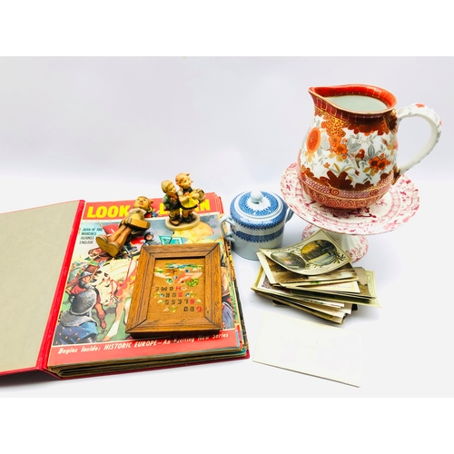 393 - Hummel figure, Spode jar and cover, bound volume of Look and Learn magazines, postcards etc
