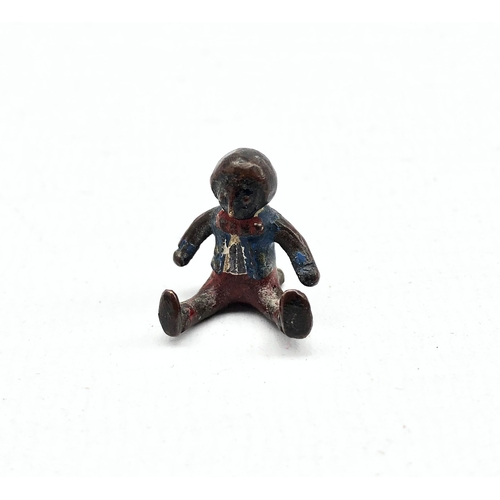 433 - Cold painted bronze figure of a seated Golliwog, attributed to Florence Upton H2cm