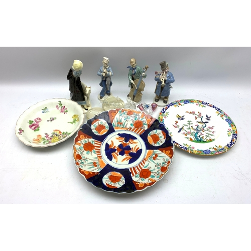 516 - Three Continental figures, plus another figure, an Imari plate, Minton plate, floral painted dish wi...