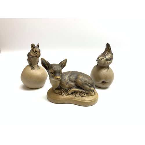 552 - Poole pottery figures, mouse and bird, each seated upon apple, and fawn, (3)