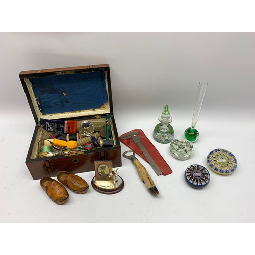 554 - Three millefiore paperweights, a millefiore paperweight inkbottle and stopper, and a controlled bubb...