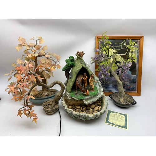 555 - Three faux bonsai type trees, decorative mirror with certificate, and water feature