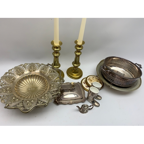 598 - Metalware including pair of brass candlesticks, dishes with swing handles etc, in one box