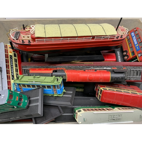 604 - Group of various bus and locomotive models, in one box