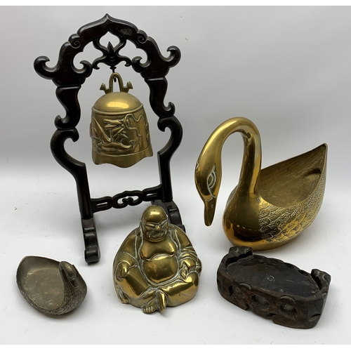 606 - Brass planter modelled as swan together with brass Buddha/Hotei, brass temple style bell upon wooden...