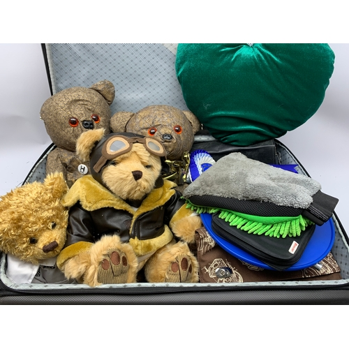 613 - Suitcase containing bears as well as large quantity of vehicle memorabilia including flasks and beer...