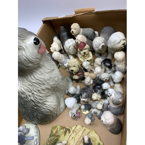 633 - Ceramic and composite figures, mostly modelled as sheep dogs, various sizes and styles including ant...