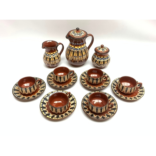 652 - Stone ware tea wares for six, decorated with marble type glaze against a brown ground
