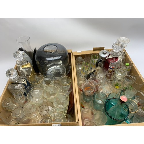 662 - Assorted glass ware, to include drinking glasses, decanters, etc., in two boxes