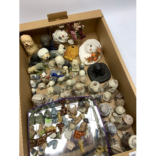 668 - Group of various small dog figures, to include a Sylvac example, plus Wade Whimsies, and other figur...